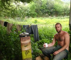 Mark Boyle (Moneyless Man) with a cup of tea, outside his caravan Date